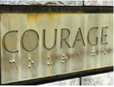 Image of the word courage with Brailled letters underneath each letter